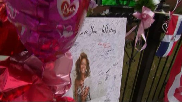 Fans created a makeshift memorial for singer Whitney Houston outside the church where her memorial is being held Saturday. (Source: CNN/WCBS)
