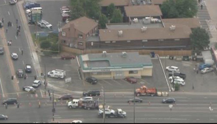 Police say one victim has died. The shooting suspect is in custody. (Source: KMGH)