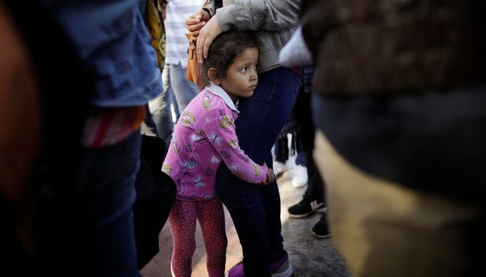 The Facebook campaign began with a $1,500 goal to help pay legal fees for immigrantfamilies. (Source: Gregory Bull/AP)
