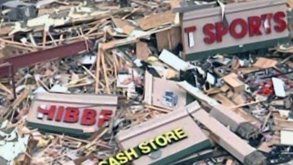 Destruction was left behind in Harrisburg, IL, after an EF4 tornado swept through the town, killing six. (Source: KTVI/KPLR/CNN)