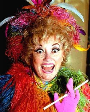 Phyllis Diller was known for her eccentric costumes, makeup and hairdos, all of which helped craft her image as America's decidedly imperfect housewife. (Source: Wikimedia Commons)