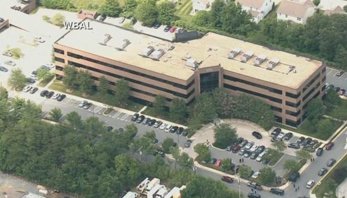 The gunman shot through the glass door to the office and opened fire on multiple employees. (Source: WBAL/CNN)