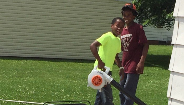 Reggie Fields 12 is mowing lawns for the summer to make money