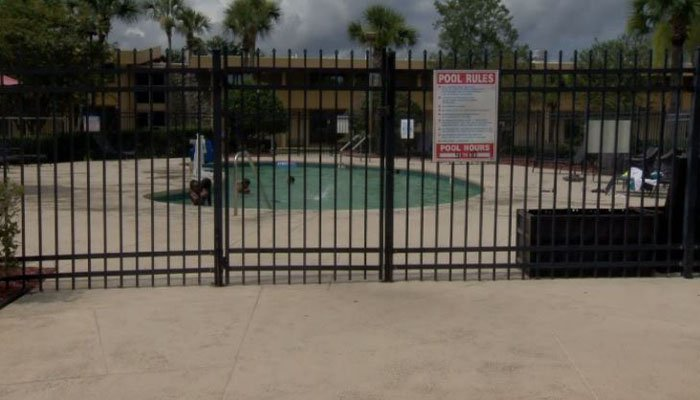 A firefighter jumped in the hotel pool to save the 3-year-old, who was face down in the water. (Source: WESH/CNN)