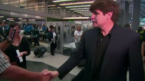 Former Illinois Gov. Rod Blagojevich shakes hands Thursday at a Chicago airport. (Source: WBBM/CNN)