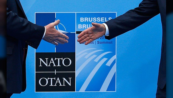 U.S. President Donald Trump, left, is greeted by NATO Secretary General Jens Stoltenberg before a summit of heads of state and government at NATO headquarters in Brussels on Wednesday. (AP Photo/Francois Mori)