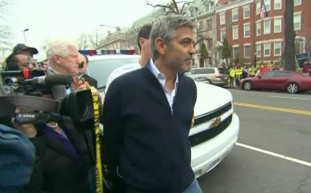 George Clooney was arrested outside the Sudanese embassy in Washington on Friday. (Source: CNN)
