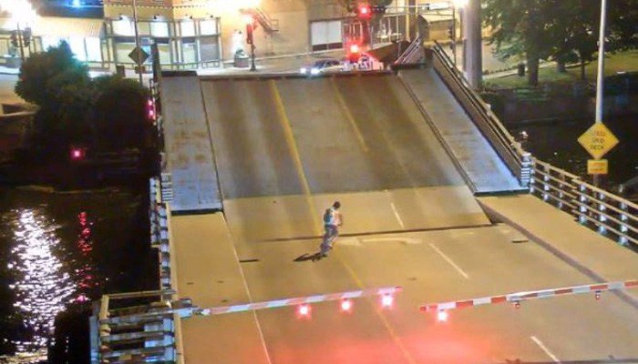 Cyclist falls into gap as bridge opens to let boat through