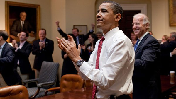 President Barack Obama, Vice President Joe Biden and senior staff members react as the House passes the healthcare reform bill, March 21, 2010. (Source: Pete Souza/White House)