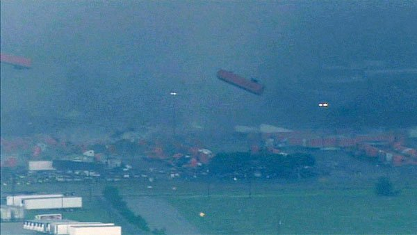 An apparent tornado flipped parked tractor-trailers into the air in Dallas. (Source: WFAA/CNN)