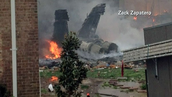 The tail of the F/A-18D Hornet Navy fighter jet that crashed into an apartment building in Virginia Beach, VA. (Source: Zack Zapatero/CNN)