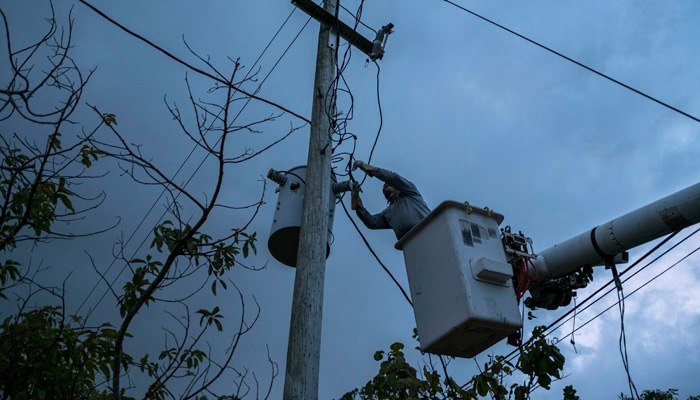 Nearly 1.4 million customers lost electric service after Hurricane Maria. (Source: Dennis M. Rivera Pichardo/AP)