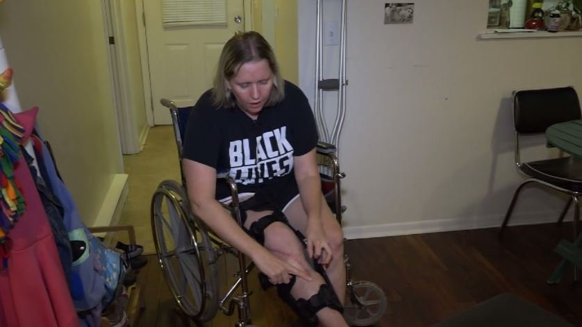 Peterson gets around town with her wheelchair and crutches, but said it's been a long healing process. (Source: WCAV/CNN)