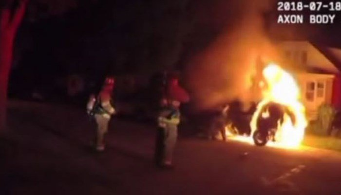 First responders broke the window with an ax and pulled the driver, who was still in his seat belt, out of the burning car. (Source: West Allis Police Dept./WITI/CNN)