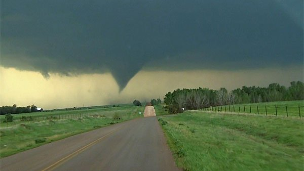 Across the south and central Plains, storm chasers broadcast images of funnel clouds roaring through rural landscapes. (Source: CNN)