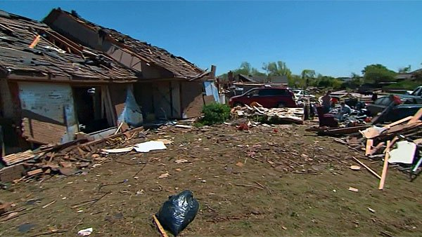 Residents of Woodward, OK, are still cleaning up after a tornado leveled approximately three-quarters of their town Saturday. (Source: CNN)