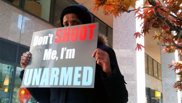 A man in Washington holds a sign protesting 'Stand Your Ground' laws on March 29. (Source: LaDawna Howard)