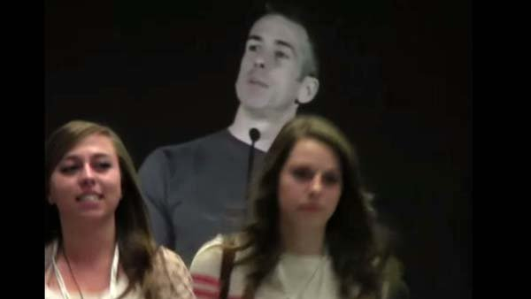 About 100 students walked out of a speech given by Dan Savage when he criticized the Bible at a high school journalism conference. (Source: YouTube/CitzenLink)