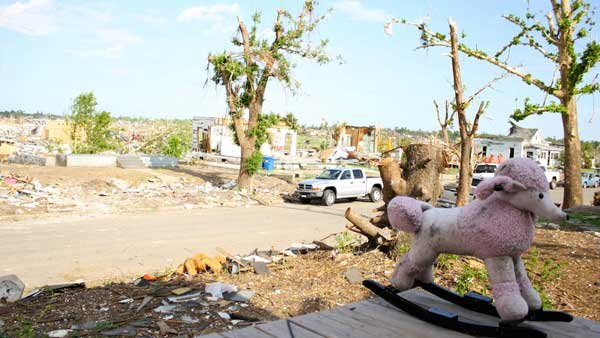 A poodle rocker sits idly on a porch one month following the devastating EF-5 tornado that hit Joplin, MO, on May 22, 2011. (Source: Eliza Smith)