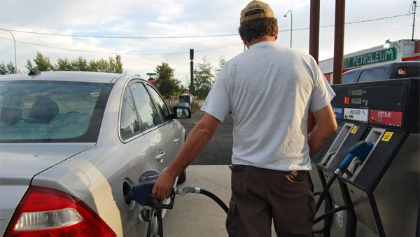 A man pumps gas in Clayton, WA. The state is one of three to see double digit price hikes from April to May. (Source: teresia/Flickr)