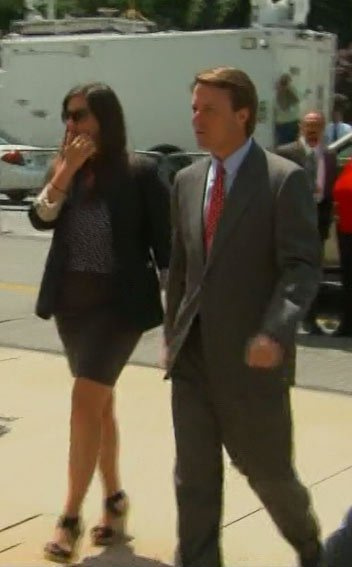 John Edwards and his daughter Cate Edwards arrive at court on Thursday. (Source: CNN)
