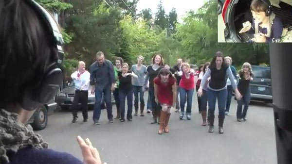More than 60 of Lamb's friends and family took to the street to dance the proposal in real time.  It's been viewed more than 4 million times on YouTube. (Source:YouTube)