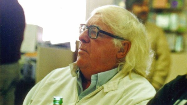 Ray Bradbury sits at a book signing in Los Angeles in the 90s. (Source: susieredshoes/Flickr)