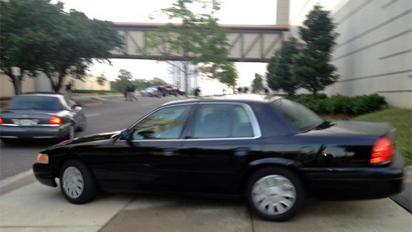 An unmarked police car which was likely carrying Leonard leaves the Montgomery County Detention Facility. (Source: WSFA)