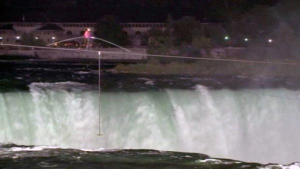 On Friday, Nik Wallenda became the first person to successfully walk a tightrope across Niagara Falls. (Source: WGRZ/CNN)