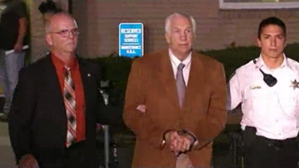 Officers led Jerry Sandusky out of the courtroom in handcuffs after jurors found him guilty on 45 counts. (Source: CNN)