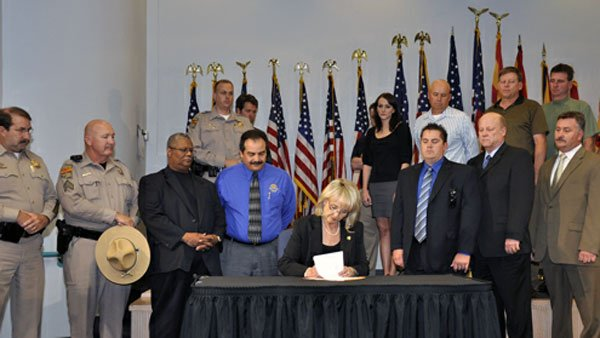 Gov. Jan Brewer signs into law Senate Bill 1070 on April 23, 2010. (Source: Office of the Arizona Governor)