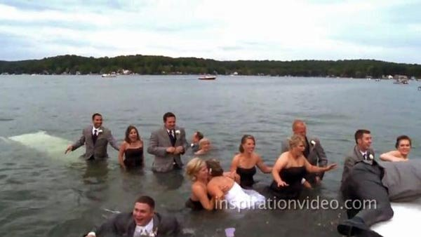 Maegan and Eric Walber's wedding party swam back to dry land after the dock they were standing on gave way.  (Source: inspirationvideo.com/YouTube)