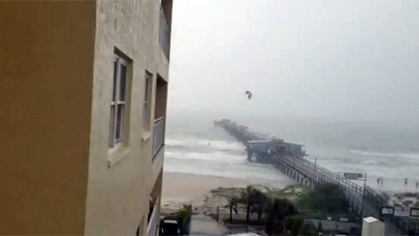 A kite surfer made good use of his idle time during Tropical Storm Debby by successfully attempting to jump a pier. (Source: YouTube)