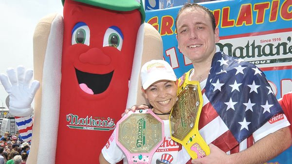 "Sonya ""The Black Widow"" Thomas, left, and Joey ""Jaws"" Chestnut, right, took home the coveted winner's belts and a $20,000 prize for their wins at the 2011 Nathan's Hot Dog Eating Contest. (Source: Major League Eating)"