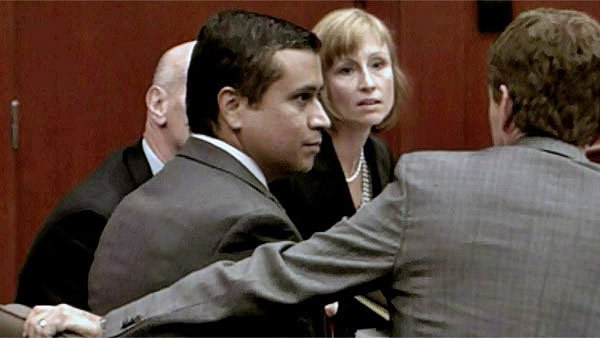 George Zimmerman, center, appears at a hearing with his attorney Mark O'Mara. (Source: CNN)