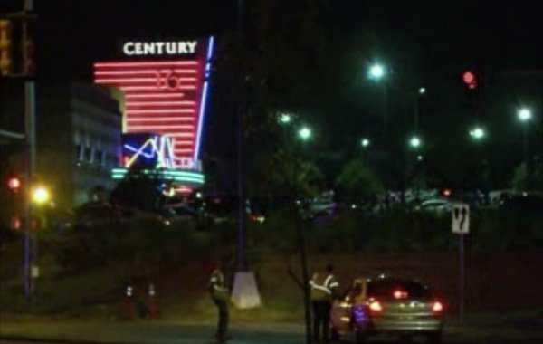 "A gunman shot and killed 12 people during the midnight showing of ""Batman, The Dark Knight Rises"" in Aurora, CO. (Source: CNN)"