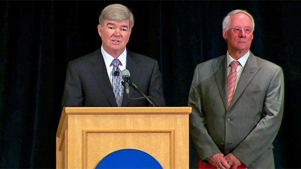 NCAA President Mark Emmert, left, and Ed Ray, chairman of the NCAA executive committee, announce the punishment to the Penn State football program. (Source: CNN)