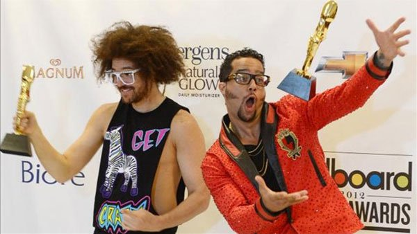 Redfoo and SkyBlu of LMFAO hold their award for Top Duo/Group of Year at the 2012 Billboard Music Awards. (Source: Jim Ruymen/UPI)