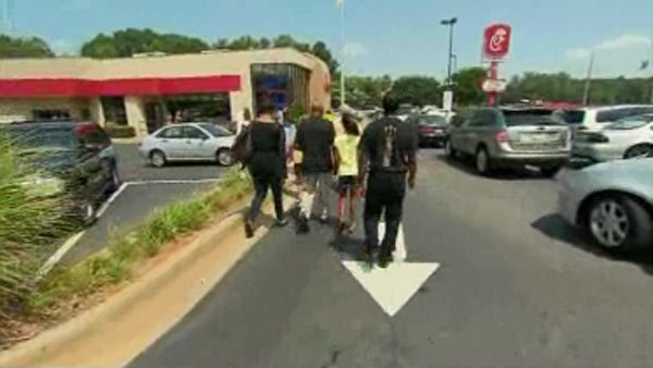 "Supporters flocked to a Smyrna, GA Chick-fil-a Wednesday in support of ""Chick-fil-a Appreciation Day.""(Source: CNN)"
