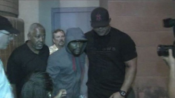 Mayweather (gray hooded sweatshirt) walked out of a Las Vegas jail on Friday after spending the last two months serving a sentence for domestic violence. (Source: KVVU)