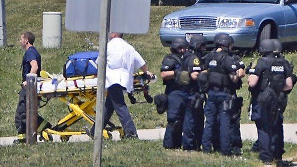 A tactical team gathers after a gunman opens fire on the Sikh Temple of Wisconsin in Oak Creek, WI, on Aug. 5. (Source: EPA)