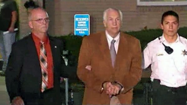 Officers lead Jerry Sandusky out of the courtroom in handcuffs after jurors found him guilty on 45 of 48 counts. (Source: CNN)