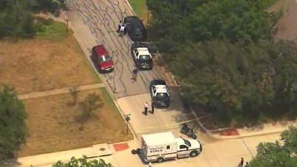 Police and emergency vehicles were on the scene after the shooting. (Source: CNN)