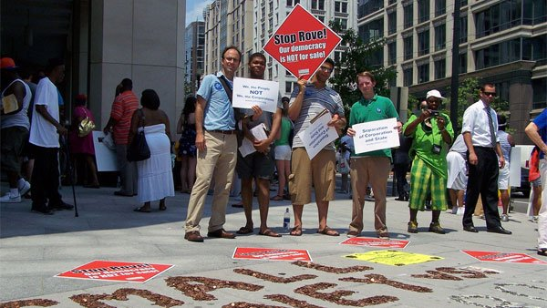 A group protests corporate influence on elections during a 2006 protest in Washington. (Source: Public Citizen/Flickr)