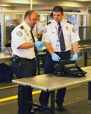 Behavior Detection Officers with the Transportation Security Administration screen baggage at the Logan International Airport in Boston. (Source: U.S. Transportation Security Administration)