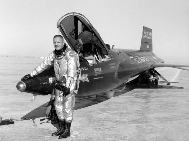 Neil Armstrong stands next to the X-15, a rocket-powered aircraft, after a test flight in 1960. (Source: NASA)