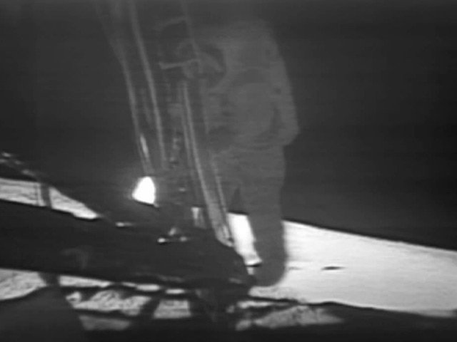 Astronaut Neil Armstrong climbs down the ladder of the lunar module onto the surface of the moon. (Source: NASA)