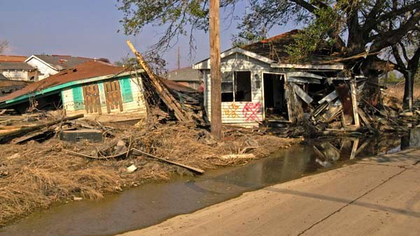 Houses in New Orleans were destroyed by flood waters after the levees broke during Hurricane Katrina. Some homes floated off their foundations and bumped into others homes or came to rest on streets. (Source: Marvin Nauman/FEMA)