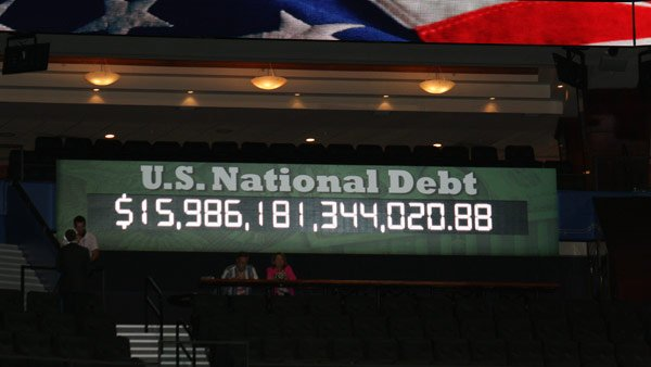 Reince Preibus, the Republican National Committee chairman, unveiled a debt clock that will track the national debt during the GOP convention. (Source: Jennifer Bowen/RNN)