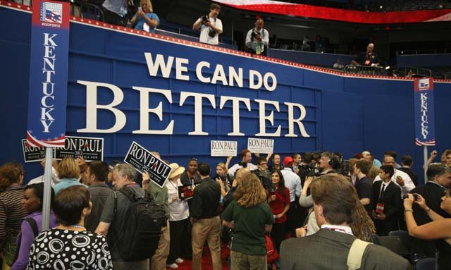 "Inside the convention hall, Ron Paul supporters held a mini pep rally, chanting ""President Paul"" and holding up signs. (Source: Jennifer Bowen/RNN)"